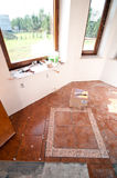 Home renovation. Detail with new tiles being installed in a room Stock Photo