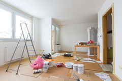 Home renovation. In room full of painting tools Royalty Free Stock Image