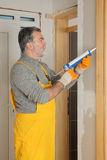 Home renovation, caulking door with silicone Stock Images