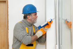 Home renovation, caulking with silicone Royalty Free Stock Image