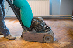 Home renovation, parquet sanding, polishing Royalty Free Stock Photos
