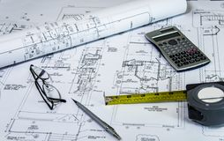 Home renovation planig, with remodel plans on architects desk. Remodeling Concept. Royalty Free Stock Images