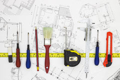 Home Renovation plans and tools. Blueprints royalty free stock photo