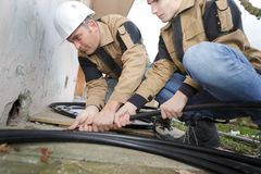 Home renovation plumber fixing sewerage pipe at construction site. Pipes Royalty Free Stock Photo
