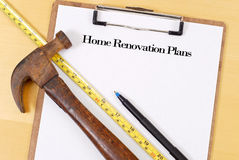Home Renovations. Home Renovation Plans On Clipboard With Accessories Stock Photo