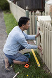Home renovator installing a new mailbox Royalty Free Stock Image