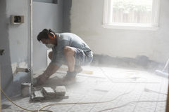 Home renovator using power tools cutting into a wall Stock Photos