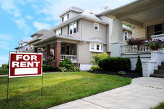 Home For Rent Sign. In Front of Beautiful American Home royalty free stock photo