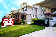 Home For Rent Sign. In Front of Beautiful American House Stock Images