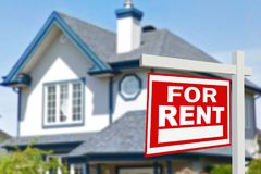 Home for rent. Sign. In front of new home Stock Photography