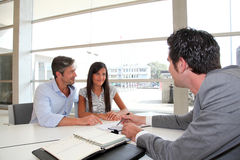 Home renting contract signature. Father and girl signing loan contract Stock Photos