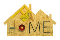 Home repair concept. Fixing materials and tools on a sheet of OSB in the form of home. Isolated objects on a white background royalty free stock photo