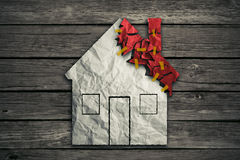 Home repair concept and house improvement symbol. As crumpled paper shaped as residential structure with torn pieces as icon for renovations maintenance Royalty Free Stock Photos