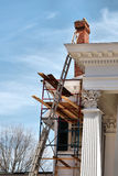 Home repair and maintenance. A white house being painted and reconstructed Royalty Free Stock Photos