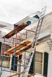 Home repair and maintenance. A white house being painted and reconstructed Stock Photography