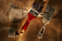 Home repairing equipments. Paintbrush and other home repairing equipments royalty free stock photography