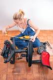 Home repairs - chair repair. Young girl prepairs to repair broken plastic chair stock images