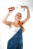 Home repairs - Electrician. Beautiful young girl fixing electricity problems stock photos