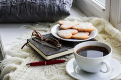 Homemade cookies, hot coffee, books. royalty free stock images