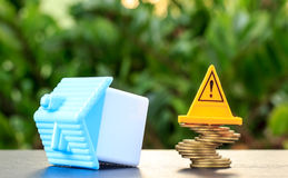 Home, Risky coin stack and Warning label.Financial crisis concep. T.Investing to buy a home is risky Stock Photography