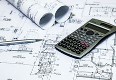 Home rmodeling planig, with renovation plans on architects desk. Remodeling Concept. Royalty Free Stock Images