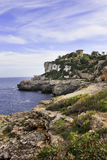 Home on rocky coastline Stock Images
