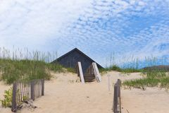 Home roof behind sand dunes  2. Home roof behind sand dunes Stock Images
