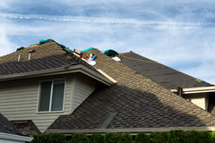 Home roof being replaced with new composite roofing materials Royalty Free Stock Photo