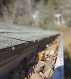 Home Roof Gutter Full of Leaves Stock Photography