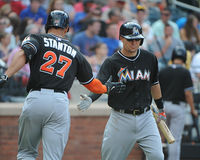 Home Run Giancarlo Stanton. Miami Marlins OF Giancarlo Stanton is congratulated by Jeff Baker after hitting a home run against the New York Mets Stock Images