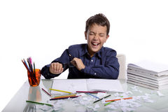 At home it's time to do homework. The boy is happy for finishing his homework Royalty Free Stock Photography