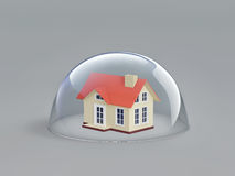 Home safety. House under glass dome Royalty Free Stock Image