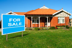 Home For Sale. Sign in Front of  New Home Royalty Free Stock Photo