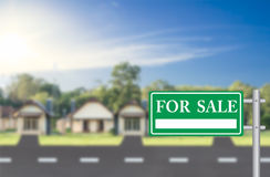 Home For Sale with green for sale sign Royalty Free Stock Image