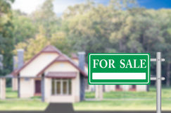 Home For Sale with green for sale sign Stock Photos