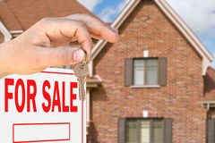 Home for sale. Hand with key Royalty Free Stock Photo