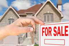 Home for sale. Hand with key Royalty Free Stock Images