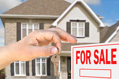Home for sale. Hand with key Royalty Free Stock Image