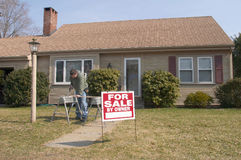 Home for sale with man working stock photography