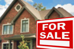 Home for sale. Sign Stock Photography