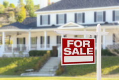 Home For Sale Sign in Front of New House Stock Photos