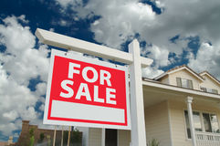 Home For Sale Sign & New Home. Home For Sale Sign in Front of Beautiful New Home Stock Image