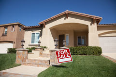 Home For Sale Sign and New House Royalty Free Stock Photo