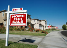 Home For Sale Signs & One Sold. In Front of Beautiful New Homes royalty free stock image