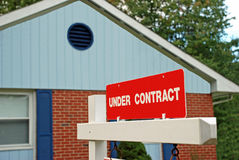 Home Sale Under Contract. A home for sale.  The sign in front advertises that it is under contract Stock Image