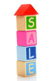 Home sale. Wooden  block of sale letters on white background Stock Photography