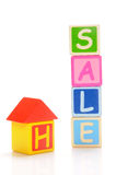Home sale. Wooden  block of home and  sale letters on white background Stock Photos