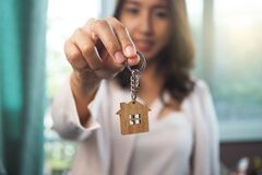Free Home Sales Agents Are Giving Home Keys. Rent A House, Buy And Sell Concept Royalty Free Stock Photography - 190831497