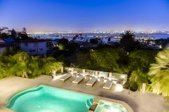 Home in San Diego county in a luxury backyard with pool in Point. Loma and a view in of downtown San Diego. Wonderful California home in San Diego county. Real Stock Photography