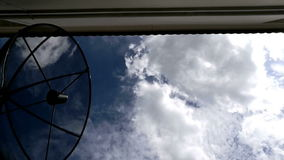 Home Satellite Dish On Blue Sky Clouds stock video footage